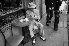 George Skeggs, Berwick St, Soho (fabiolug) Tags: street leica people blackandwhite bw man london cup coffee monochrome hat bar writing table blackwhite cafe chair shoes artist sitting dress notes chairs candid 28mm soho wide streetphotography bowtie rangefinder wideangle suit monochrom westend berwickstreet biancoenero candidphotography londonist elmarit berwickst leicam elmarit28mm leicaelmarit28mmf28asph elmarit28mmf28asph leicaelmarit leicaelmarit28mm mmonochrom leicammonochrom leicamonochrom georgeskeggs