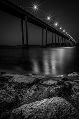 Evening in Svendborg (Andris Nikolajevs) Tags: longexposure bridge sea blackandwhite seascape water monochrome landscape denmark lights mono coast canal rocks le bnw svendborg