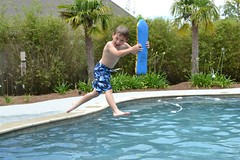 Splash! (ebarbier) Tags: pool kid splash leap kickboard