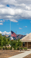 Flags at half-mast (randyherring) Tags: california park ca sky nature clouds us afternoon unitedstates outdoor sanjose flags historical visitorcenter recreational santaclaracountyparks martialcottlepark martialcottlefamilyranch