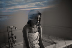 wash away my memories (Hanna Emmilyn) Tags: city sunset summer portrait sky blackandwhite bw woman cloud sun color art beach water girl clouds photoshop canon pose dark hair person photography photo sand waves alone darkness arms skin artistic body