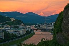 """Red hour"" in Salzburg (echumachenco) Tags: salzburg austria sterreich salzach river water sky red pink eveningpink evening sunset city bridge hill hillside kapuzinerberg clouds light nikond3100 view viewpoint panorama outdoor serene cliff"