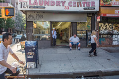 1st Ave Laundry CeNter (mookie.nyc) Tags: nyc summer eastvillage candid gritty chilling newyorkers 1stave thebigapple thedecisivemoment thehumanelement candidstreetphotography laundrycenter grittycity summerinnyc canon5dmarkiii therealnyc