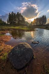 Stones at Lake (arq.alextoro) Tags: sunset paisajes lake sol landscapes stones paisaje lagos atardeceres neblina piedras equinoccio stoneatlake