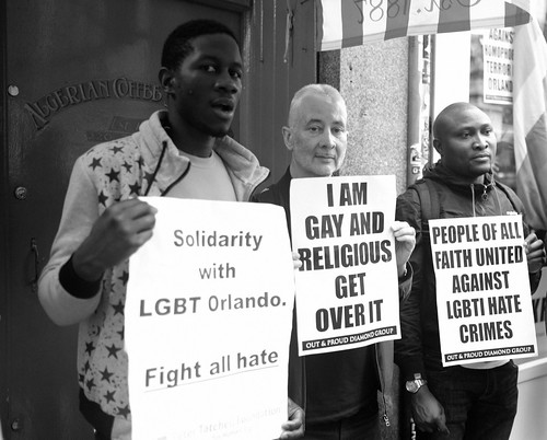 Solidarity with LGBT Orlando - Fight all hate - Activists with placards at London's vigil in memory of the victims of the Orlando gay nightclub terror attack.