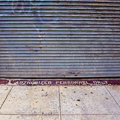 you gotta be authorized (MyArtistSoul) Tags: ventura ca nearjuniperothompson big abandoned building old rusty rollupdoor graffiti red warning sign sidewalk urban square minimal lines pattern texture partoftheseries waitingtodrinkbeerattopatopa 0651 s100