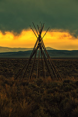 Fire Sky ([ raymond ]) Tags: sunset storm newmexico southwest vertical clouds landscape sigma nativeamerican frame taos teepee tipi tepee americansouthwest img7850