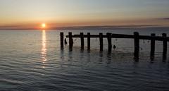sun-up (martinaschneider) Tags: sky sun lake ontario beach water clouds sunrise pier spring lakeontario fiftypoint