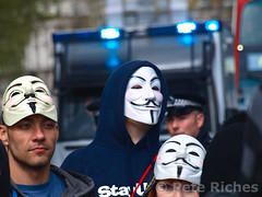 P5045470 (pete riches) Tags: uk london westminster protest police flags demonstration banners anonymous whitehall slogans placards bluelights metpolice austerity occupy anons spendingcuts vmasks peteriches occupylondon wearethe99 anonymousmasks vforvictorymasks