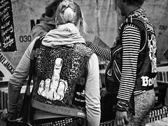 Stinkefinger (kohlmann.sascha) Tags: street people blackandwhite bw woman man berlin monochrome de deutschland clothing punk dress market streetphotography streetportrait menschen clothes event mann vest monochrom frau gesture markt schwarzweiss veranstaltung fleamarket waistcoat trdel cutoff mensch kleidung flohmarkt punker stinkefinger kutte geste bekleidung weste schwarzweis schwarzwei streetfotografie strasenfotografie straenfotografie trdel flipsomeonethebird givesomeonethebird givesomeonethefinger ilobsterit