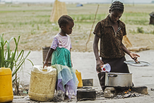 """Charity begins at home"", Zambia. Photo by Felix Clay/Duckrabbit, 2012."