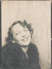 Photo booth: Akward smiling woman (simpleinsomnia) Tags: old woman white black monochrome vintage booth fur found photo blackwhite photobooth antique photograph foundphotograph vision:outdoor=0806