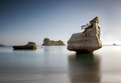 Little-Stack (petefoto) Tags: longexposure blue newzealand seascape beach landscape waves peace atmosphere boulders coastal waikato filters foreshore stacks hahei cathedralcove coromandelpeninsula nd110 mercurybay nikond700 bestcapturesaoi elitegalleryaoi leefilters09sgrad