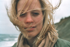 Anni (Juliet Alpha November) Tags: ocean sea portrait film water face analog see coast gesicht meer wasser waves wind jan windy portrt baltic 200 analogue ostsee kste wellen windig rossmann meifert