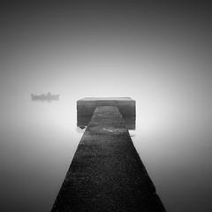 Lost (ilias varelas) Tags: light sea blackandwhite white mist black water monochrome fog mono pier boat mood atmosphere greece ilias varelas