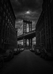In Between (roken-roliko) Tags: city nyc newyorkcity bridge blackandwhite white newyork black architecture clouds dark grey fineart perspective dramatic brooklynbridge traveldestinations dramaticclouds usaamerica cityandarchitecture rolandshainidze