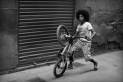 the iron horse of mine (bostankorkulugu) Tags: barcelona street boy urban blackandwhite bw white black monochrome bicycle sepia blackwhite kid spain europe child catalonia catalunya curlyhair bostanci santpere decisivemoment bostan korkut espanya bostankorkulugu carrerdencortines carrerdecortinas