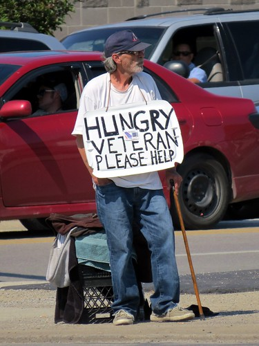 We see so many people begging for money it numbs us., From FlickrPhotos