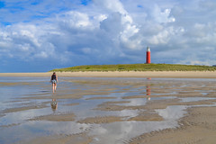 Lighthouse, girl and sand (MicheleSana) Tags: trip travel sea summer mer lighthouse holland reflection beach nature netherlands girl clouds strand walking faro europe nuvole mare estate cloudy walk north nederland natuur zee zomer fille plage phare zon vuurtoren spiaggia texel meisje olanda nord zand lt riflesso 2014 benelux paesi camminare bassi lesoleil bezinning lesable larflexion