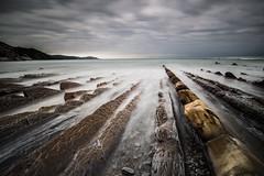 Les flyschs d'or (Herv D.) Tags: seascape lines sunrise landscape coast rocks cte atlantic shore geology paysage basquecountry roches sakoneta leverdesoleil paysbasque atlantique guipuzkoa flashs