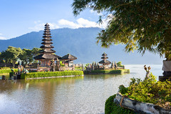 Pura Ulun Danu Bratan (Evgeny Ermakov) Tags: travel blue sky bali cloud mountain lake building tree bird heritage nature water architecture clouds indonesia asian religious island temple ancient asia southeastasia view famous religion landmark exotic destination southeast hindu pura ulun danu touristic balinese bratan beratan bedugul puraulundanubratan puraulundanuberatan