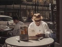 Whats for My LunchFilm. (Janey Song) Tags: street people men lunch 35mmfilm vancouvercanada zeissikoncontessa kodakektar100 carlzeisstessar45mmf28 carlzeiss45mmf28 zeissikoncontessa1953