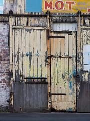 back street garage 02 jul 16 (Shaun the grime lover) Tags: street door wood building texture sign wooden back warrington paint industrial garage backstreet doorway flaking mot liverpoolroad bankquay greatsankey
