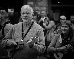 The ukulele player (Frank Fullard) Tags: portrait musician music festival festive happy mono fan ukulele player strings admirer fullard frankfullard