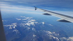 Somewhere over the Rockies (BarryFackler) Tags: trip sky snow mountains window clouds plane airplane landscape flying scenery outdoor aircraft aviation horizon flight wing jet aerial vista vehicle winglet americanairlines airliner windowseat flaps airplanewing 2016 boeing757 barryfackler barronfackler