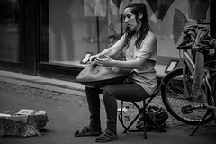 Street music (MacCabri) Tags: street blackandwhite musician music playing girl monochrome copenhagen performing streetphotography streetcapture