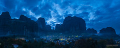 Kastraki Before Dawn (Darby Sawchuk) Tags: morning travel blue vacation cliff holiday weather rock stone clouds greek dawn lights town sandstone rocks europe european village pillar unescoworldheritagesite greece geology pinnacle meteora kastraki