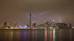 42-27700012 (manhhung) Tags: city sky toronto ontario canada storm reflection building tower water skyline night skyscraper river outdoors cityscape cntower stadium illumination officebuilding nobody landmark dome skydome northamerica thunderstorm flowing lightning lighteffect urbanscene overcastsky fuelandpowergeneration