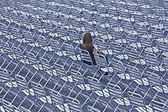 Leave Her Waiting (CoolMcFlash) Tags: vienna wien street woman texture lines canon person photography eos austria sterreich waiting alone sitting fotografie audience chairs geometry many empty patterns leer row repetition frau tamron viele reserved muster gettyimages sessel warten repeating geometrie sitzen rathausplatz sitzend linien zuschauer textur alleine reihen strase 18270 reserviert zuschauen wiederholungen 60d b008