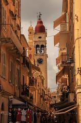 Tangled streets & busy pavements! (Jay Bees Pics) Tags: street church buildings island europe mannequins belltower greece shutters lamps corfu kerkyra oldtown canopies bustling ionianislands 2013 reddome saintspyridon