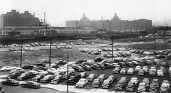 Newark Avenue with Pennsylvania Railroad tracks between Henderson and Warren Steets looking northeast to the Harborside Terminal on the Hudson and NYC. Jersey City. 1957 (wavz13) Tags: urban industry dark industrial noir moody grain trains bleak oldphotographs grainy oldphotos oldcars railroads vintagecars factories wasteland urbanlife dystopia noire oldfactory urbanwasteland oldindustry industrialwasteland 1950scars dystopic oldfactories bleakwasteland vintagefactory oldrailroads oldjerseycity 1950sphotos 1940scars vintageindustry jerseycityhistory newjerseyhistory 1950sphotography brickfactories 1950snewyork forgottenrailroads industrialnewjersey vintagejerseycity vintagerailroads vintagenewjersey vintagefactories oldnewjersey 1950sjerseycity 1950snewjersey industrialjerseycity 1950sphotographs 1950manhattan