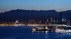 Benidorm al anochecer./ Nightfall in Benidorm. (Recesvintus) Tags: city blue sea urban espaa costa mountains beach water azul skyline night skyscraper buildings landscape lights luces noche coast mar twilight spain edificios agua europe mediterranean dusk ciudad playa alicante viewpoint mirador mediterrneo anochecer benidorm nightfall montaas crepsculo rascacielos costablanca boadwalk canoneos50d goldcruzadas canonef2485usm recesvintus mygearandme mygearandmepremium mygearandmebronze mygearandmesilver cruzadasii vision:mountain=0635 vision:sunset=0602 vision:outdoor=099 vision:clouds=0851 vision:sky=0943