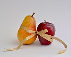 Tie the Knot (njk1951) Tags: apple fruit bow pear ribbon redapple yellowpear tietheknot pearapple blinkagain