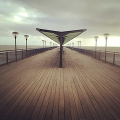 a walk down to Boscombe Pier, in an incoming storm (.FuturePresent.) Tags: square squareformat rise iphoneography instagramapp uploaded:by=instagram foursquare:venue=4c1f7d39b306c928467c68b7