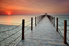 : Sunset Over The Jetty : (fiz_zero) Tags: sunset red sea sky orange sun seascape art beach nature sunrise landscape photography seaside nikon asia natural artistic background jetty fineart explore malaysia penang filters waterscapes gnd greatphotogr