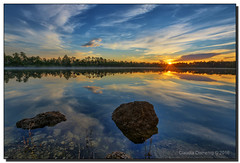 Serene Sunrise (Fraggle Red) Tags: morning trees sun lake clouds sunrise reflections dawn nationalpark rocks florida everglades evergladesnationalpark pinetrees hdr enp 7exp canonef1635mmf28liiusm miamidadeco dphdr pinegladeslake