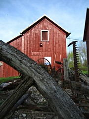 Afternoon Light (AmyEAnderson) Tags: county wood red sky wheel wisconsin barn rural wagon farm tools historic planks sauk bucolic