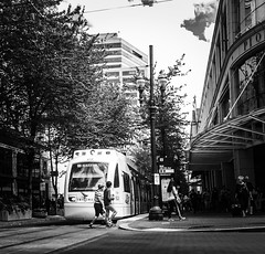 Where The Shoppers Go (TMimages PDX) Tags: road street city people urban blackandwhite monochrome buildings portland geotagged photography photo image streetphotography streetscene sidewalk photograph pedestrians pacificnorthwest avenue vignette fineartphotography iphoneography