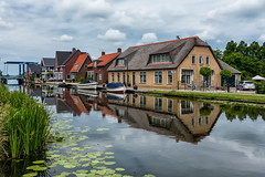 Near Woubrugge (PaulHoo) Tags: sky house holland reflection water netherlands architecture clouds landscape lumix hdr woubrugge 2016