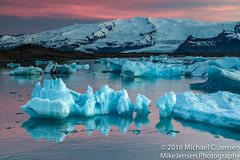 The Majesty of Midnight (Michael C. Jensen) Tags: sunset ice iceland lagoon glaciers pinksky icebergs midnightsun jokulsarlonlagoon vatnajkullglacier floatingicebergs