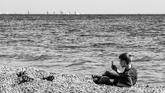 Photographing boy in Nice, France 14/4 2010. (photoola) Tags: boy sea blackandwhite france beach water monochrome mobile strand barn mar nice mediterranean child mobil sv hav mediteranean mittelmeer medelhavet photoola