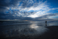 it takes courage to stand alone (Bec .) Tags: ocean blue light sea woman beach water silhouette clouds canon walking person waves shore adelaide bec southaustralia 1022mm henleybeach 450d ittakescouragetostandalone