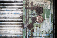 confessional (james_drury) Tags: door rusty crusty factory bashed grill smashed paint peeling decay ht birmingham green blue canonef2470mmf28liiusm