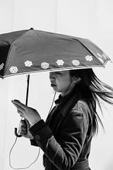 Multitasking (aaron.ackerley) Tags: kyushu japan fukuoka street photography streetphotography blackandwhite