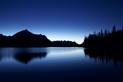Midnight Blue Kananaskis (John Andersen (JPAndersen images)) Tags: blue sky panorama lake clouds reflections stars pond colours alberta