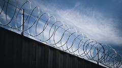 blue skies through barb wire (Steve Stanger) Tags: street newjersey nikon camden nj streetscene barbwire d7000 nikond7000